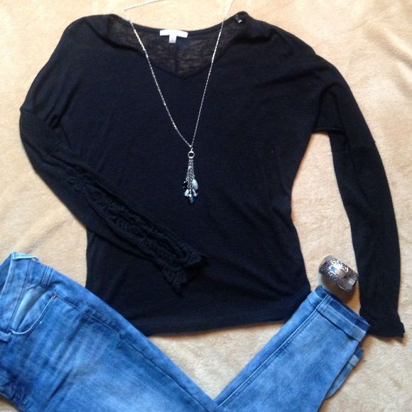 Black lightweight sweater Lightweight plain black sweater with cute lace design on the sleeves. Only worn twice.. No stains or holes Amber blue Sweaters