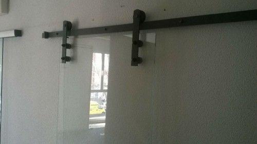 Puerta de cristal r stica corredera guia corredera for Herrajes para puertas correderas rusticas