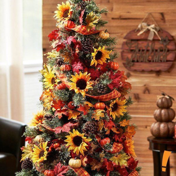 Repurpose your tree for any time of year! Instead of lights and ornaments, add floral accents and ribbon for the Fall