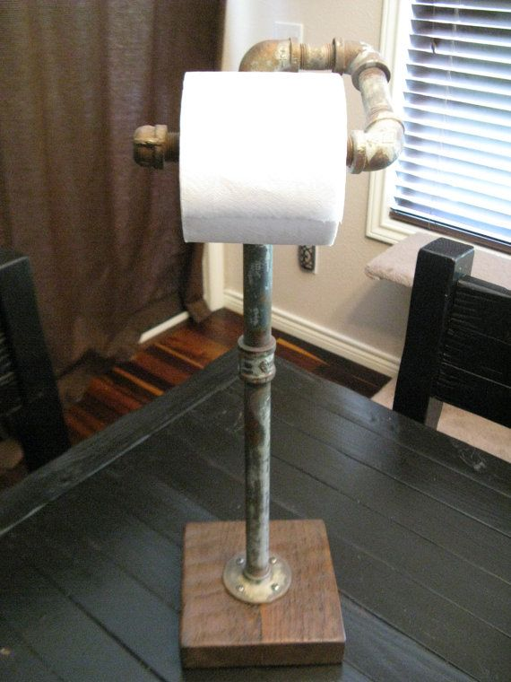 free standing toilet paper holder made from water pipe and