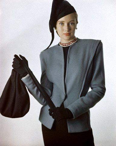 Smart, collarless, grey wool jacket worn with an Amrose beret hat, black gloves…