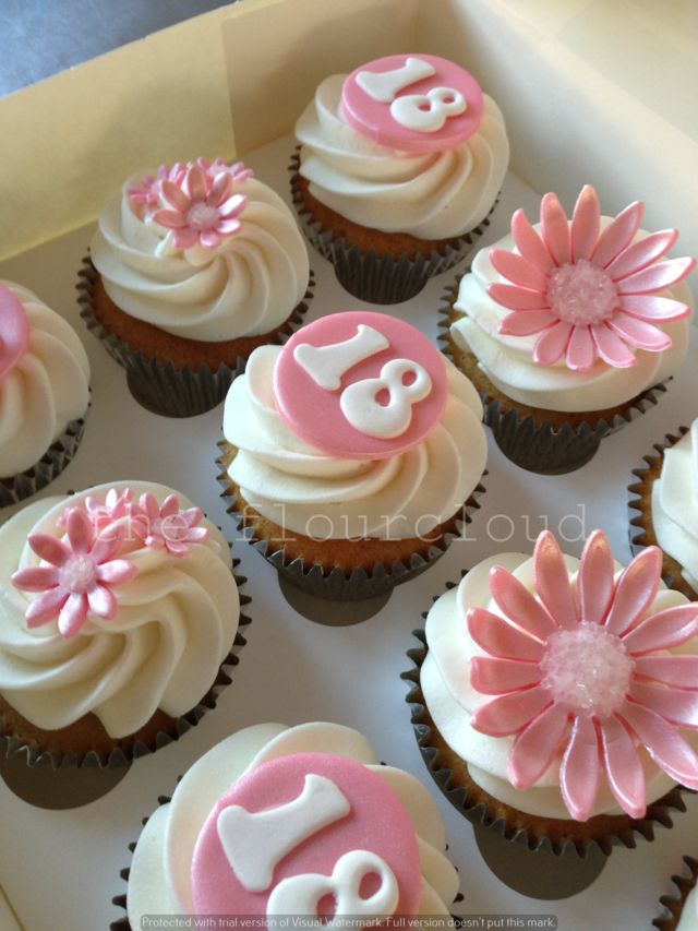 Pretty pink flowers on these 18th birthday cupcakes everything
