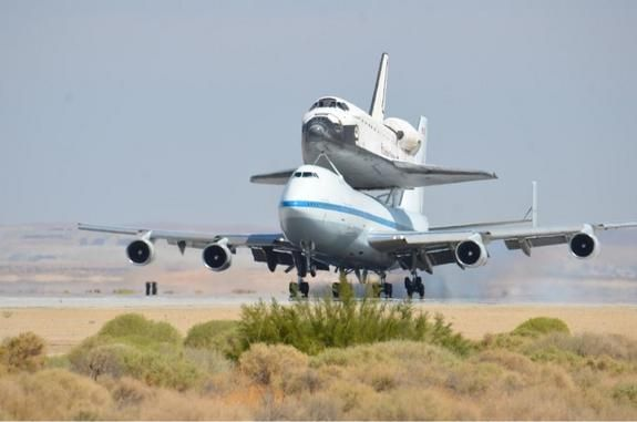 NASA's Space shuttle Endeavour, riding piggyback atop a Shuttle Carrier Aircraft, lands at NASA's Dryden Flight Research Facility in Southern California on Sept. 20, 2012, during the final shuttle ferry flight...photo from www.space.com