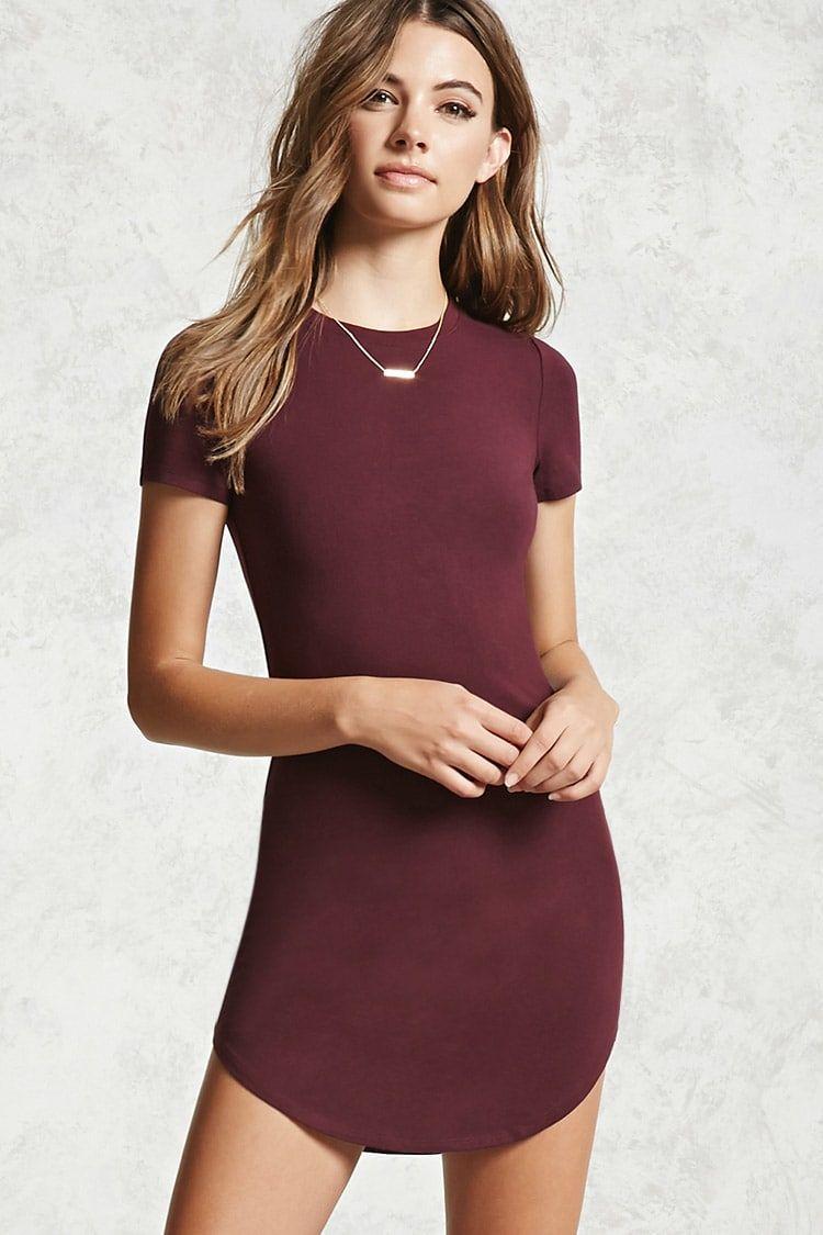 A Knit T Shirt Mini Dress Featuring A Scoop Neckline Curved Hem