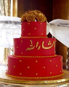 Three tier red and gold chinese theme wedding cake decorated wtih