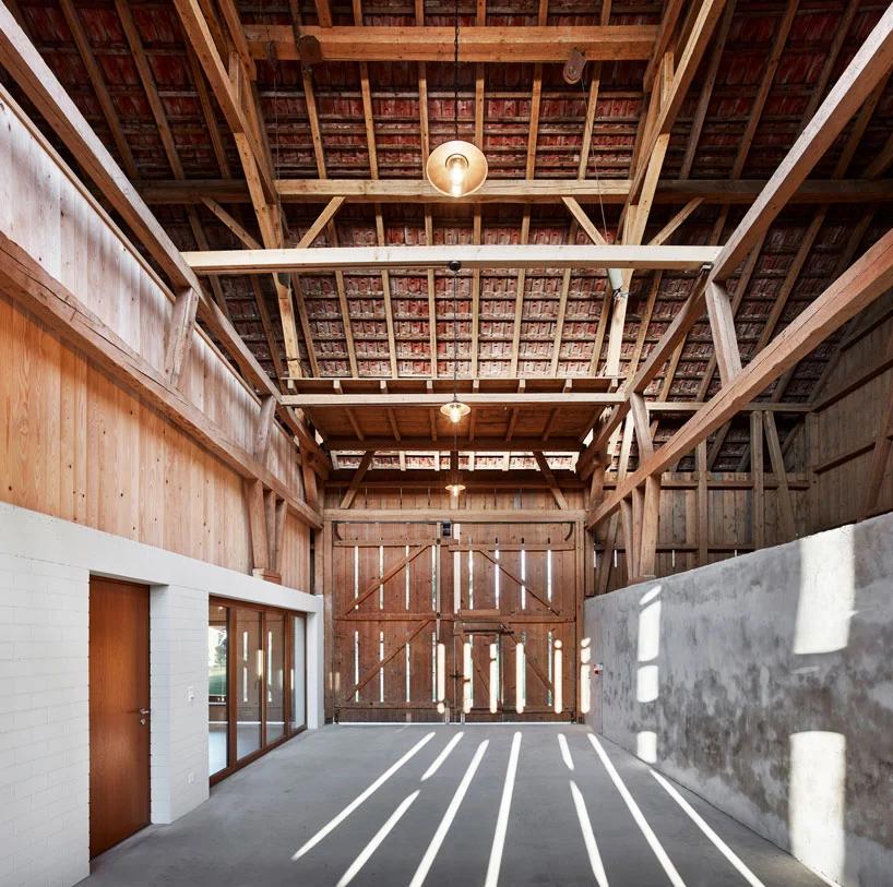 MJ2B architekten turns a former barn into apartments in cordast, switzerland