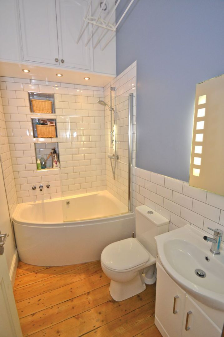 New corner bath with curved glass shower screen installed by our ...