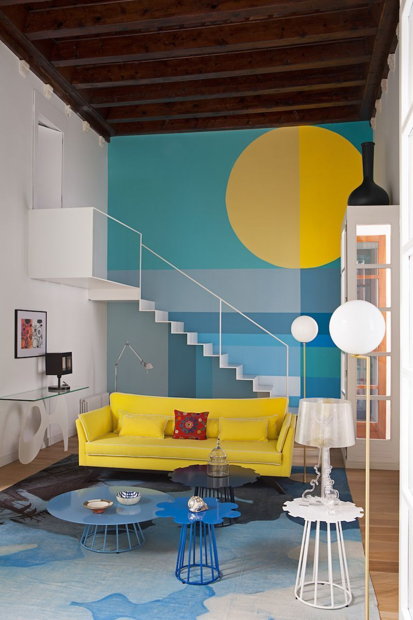 Bright colors and modern furniture create a vibrant happy space