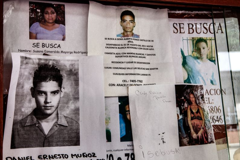 Posters of missing persons in the headquarters of the Institute of - missing persons posters