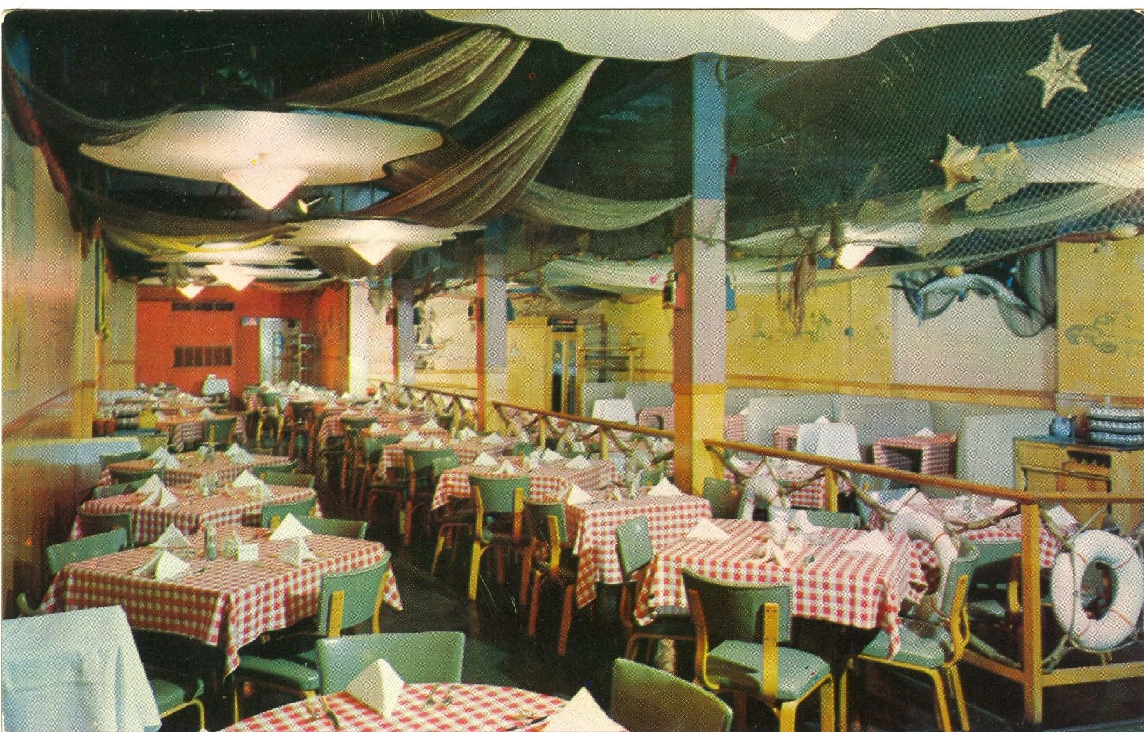 "Seafood Bay at 179 N. High Street.  ""Ohio's Great Steak and Lobster House""  Friendly service - diverting tidewater atmosphere. Live fish and turtle swim in our window aquarium.  Courtesy of Columbus Landmarks Foundation and the collection of Doreen Uhas Sauer."