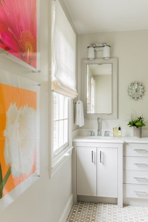 Beautiful bathroom with pink and orange floral art framed in clear ...