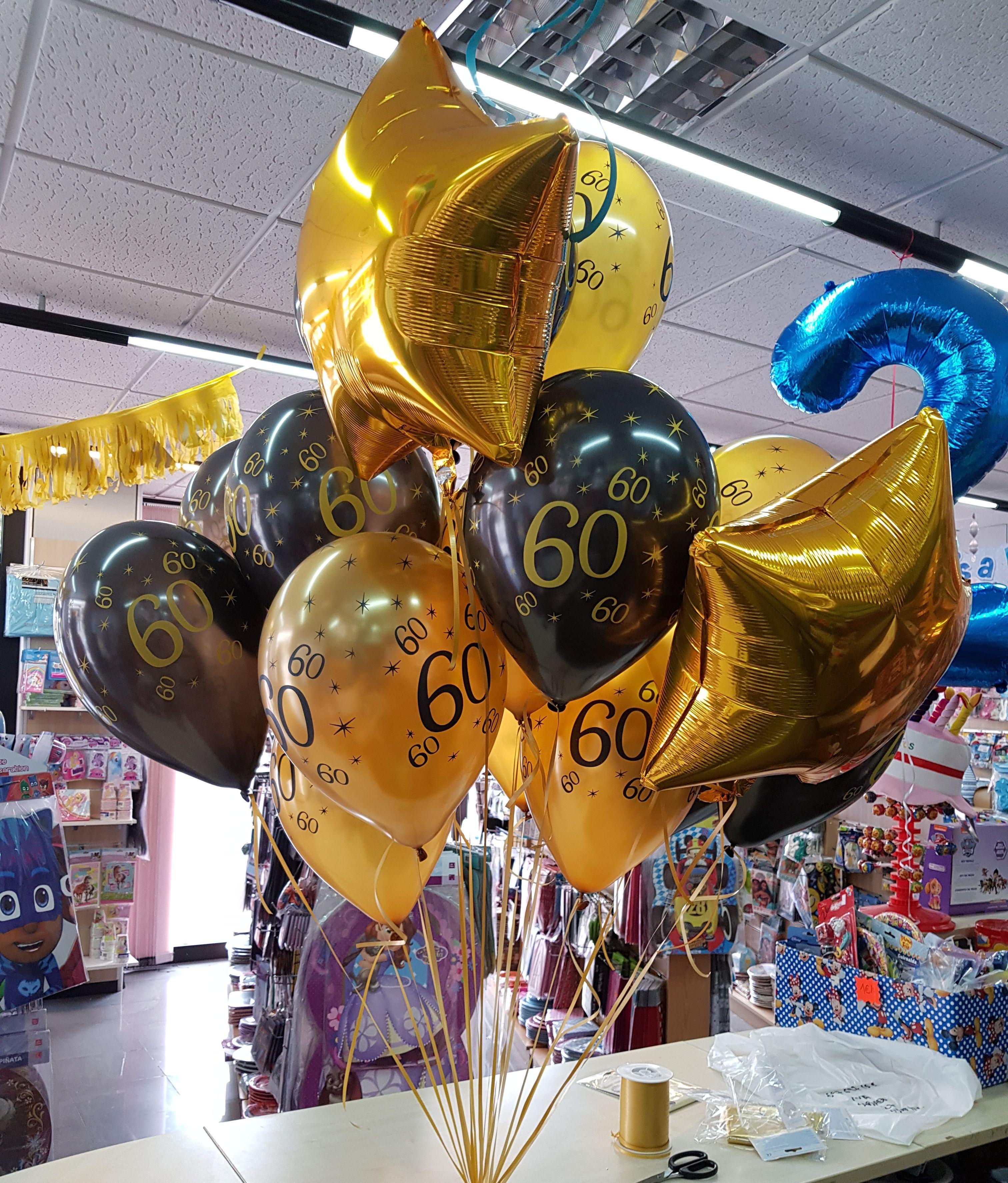 18c1a16cd Centro de globos para celebrar un 60 cumpleaños. Todos los globos los  podeis venir a