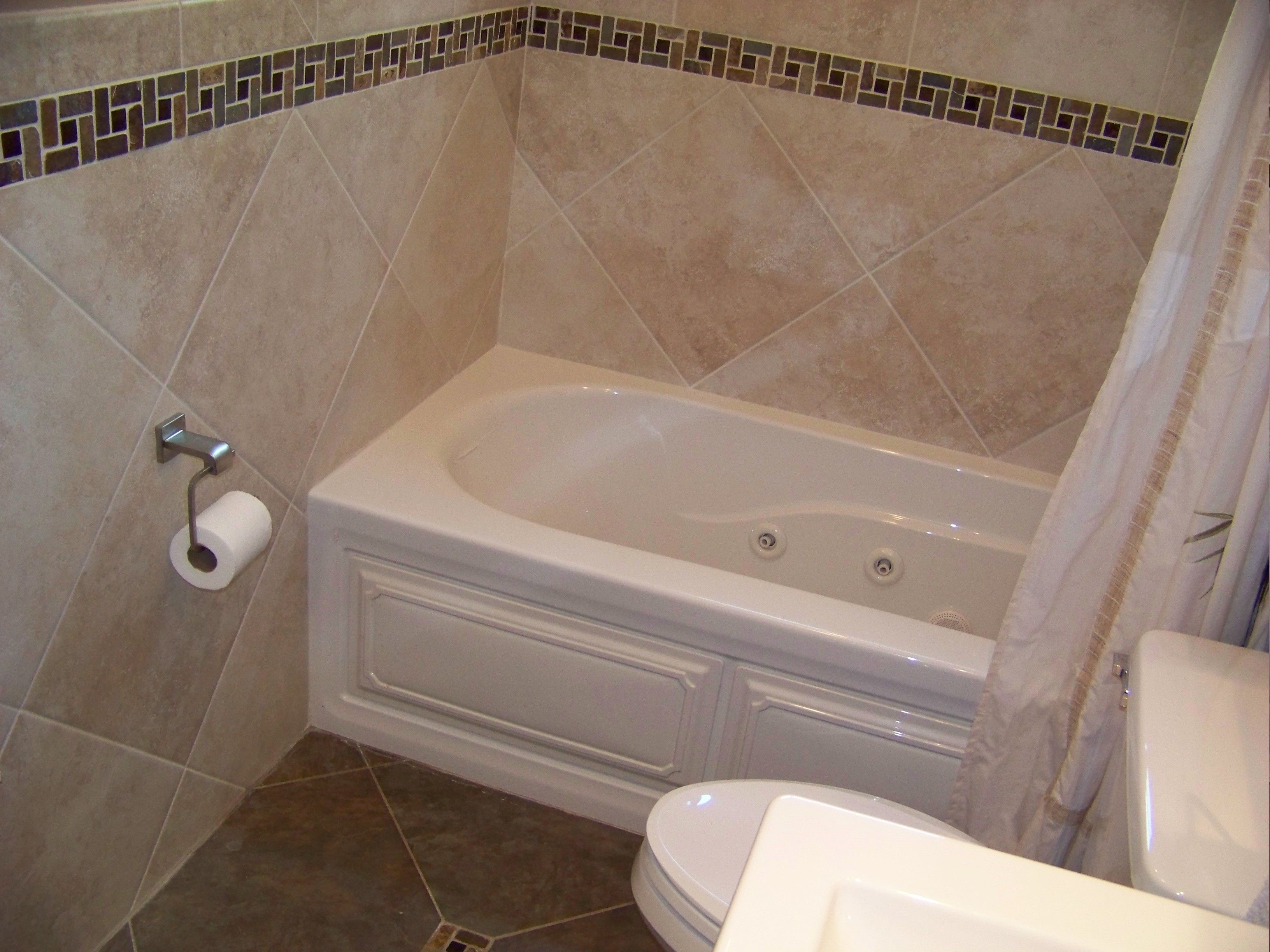 diagonal tile bathtub | ... tile to accent the tile banding above ...