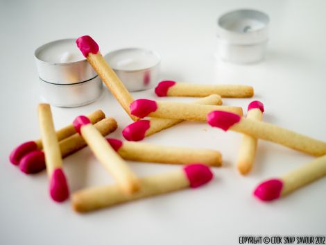 """Matchstick Cookies: """"I won't lie to you, the matchsticks are labour-intensive. They're easy to do, but labour-intensive nonetheless, so you probably should set aside a good half day or more if you're making the whole recipe. The best thing about them though is that you get soooooo many from the recipe (I got 319)"""" 390g flour, ½ tsp salt, 1 tsp baking soda, 224g butter, 200g sugar, 2 eggs, 2 tsp vanilla extract, 200g icing sugar, 1 tbs syrup, 1 tbs milk, food coloring.   Cook.Snap.Savour"""