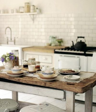 White kitchen with rustic wooden table