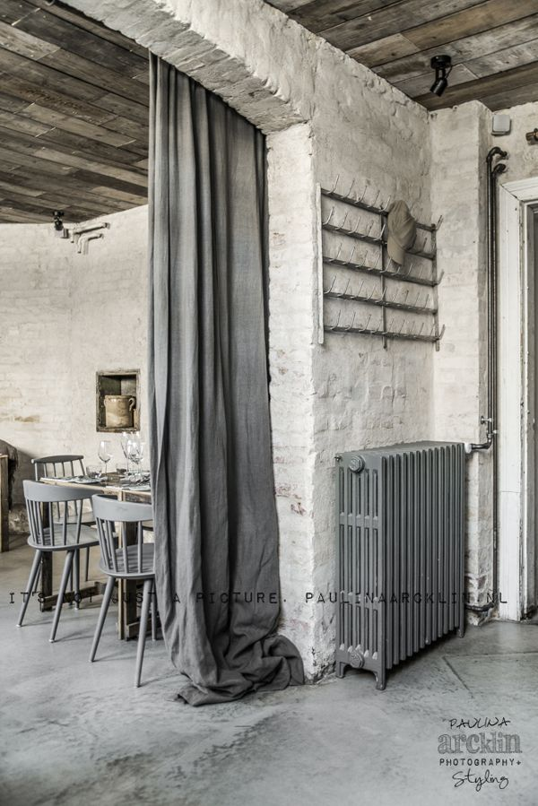 Oh my. Exposed floorboards, rustic walls, raw floor... weathered wood... gathered drapes. Love this.