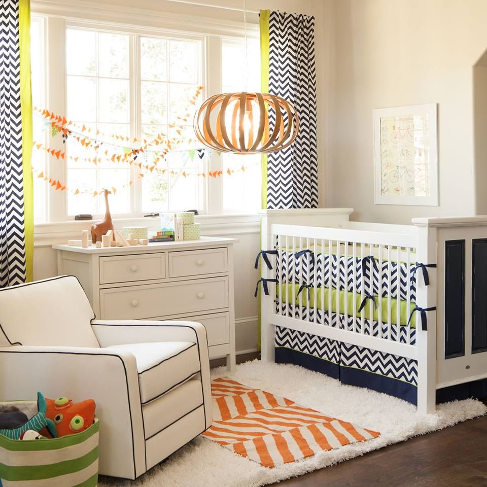 Navy chevron curtain and bedding is from Carousel Designs