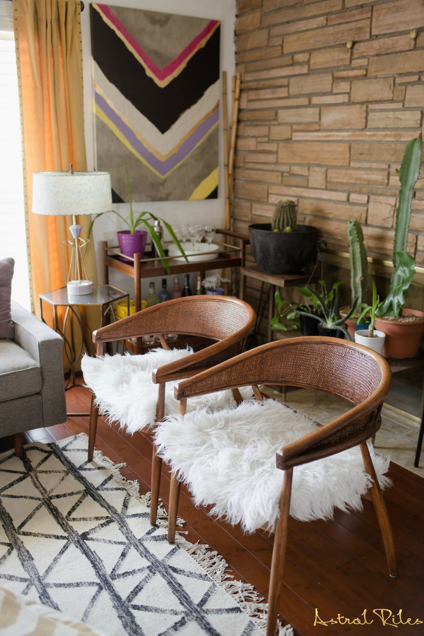 retro - vintage modern living room. cane back chair with faux fur