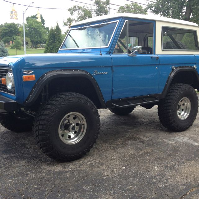 Early Bronco Steel Blue With Huge Tires On Aluminum Rims With