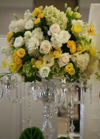 Yellow cream white and green reception wedding flowers for Yellow flower centerpiece ideas