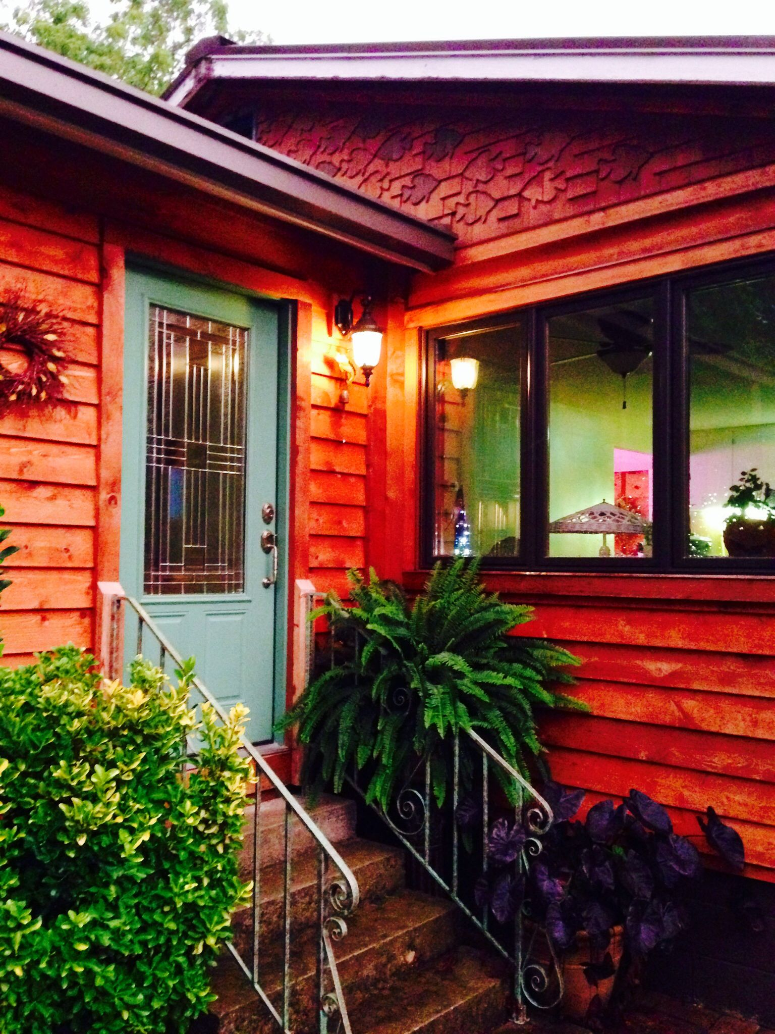 Cabin Front Door Color And Handmade Fish On Cedar Siding Front Door Cedar Homes Front Door Colors