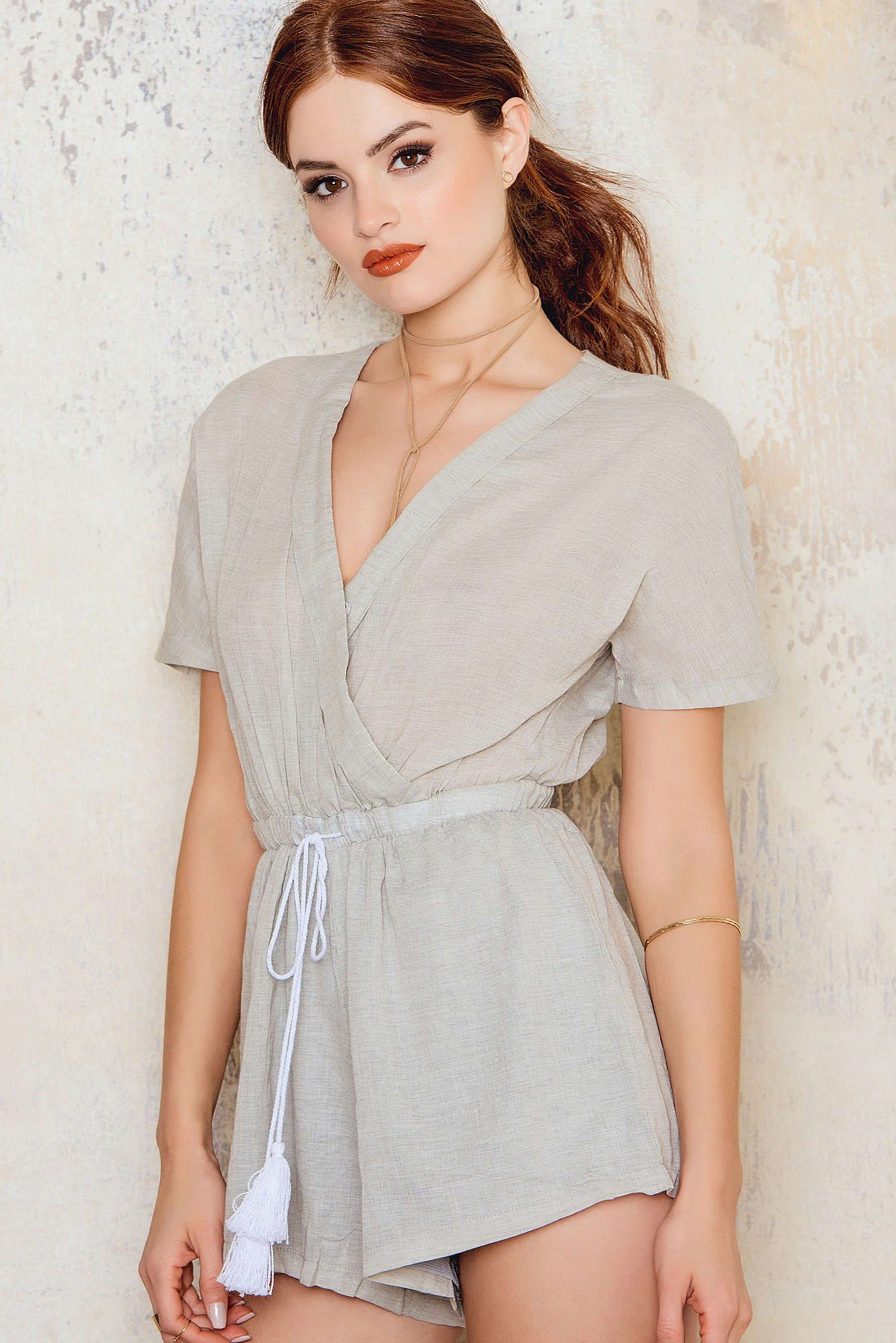 6c65124542 This playsuit is a true eye-catcher! The Linen Billow Front Playsuit by Toby  Heart Ginger comes in light grey and features a wrap-around v-neck…