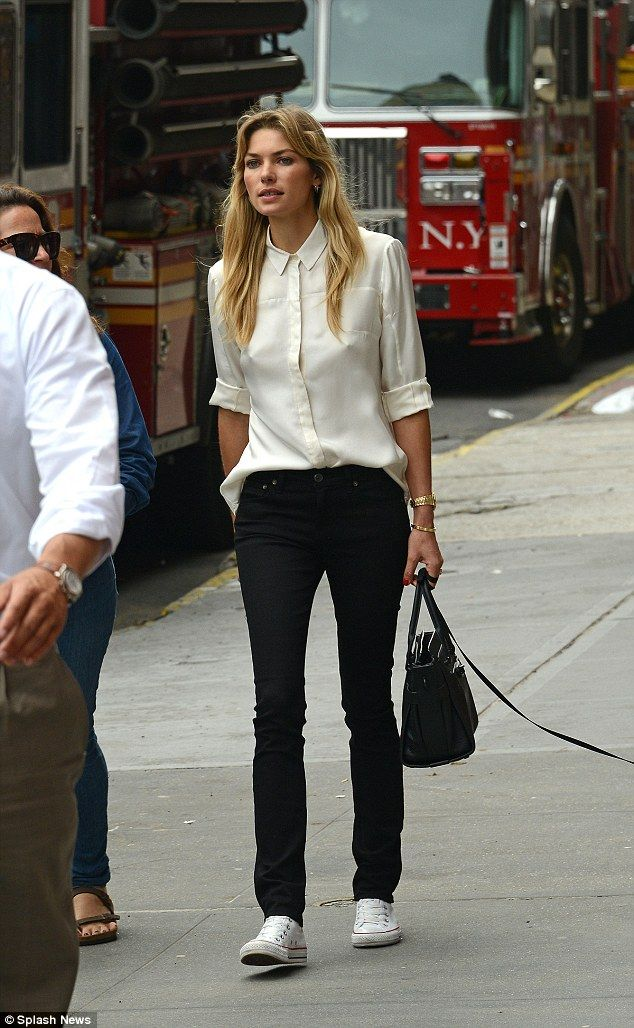 1c5bd19103afb Jessica Hart braless under her silk shirt while walking her dog in New York  City.