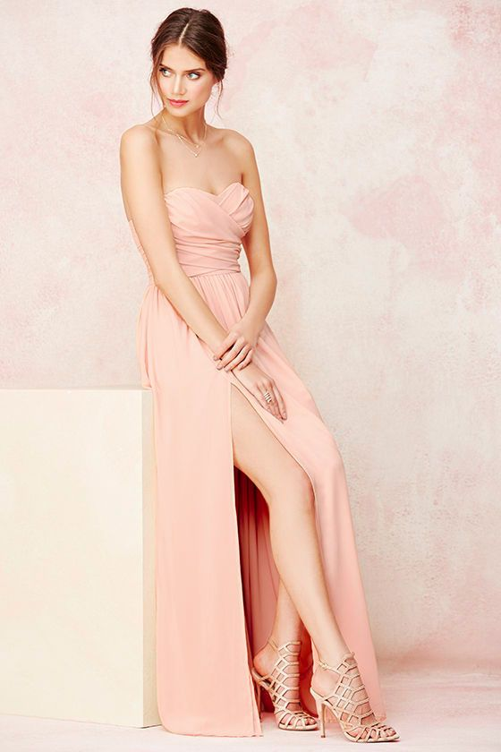 You'll be admired as soon as you set foot in the party wearing the Moonlight Serenade Peach Strapless Maxi Dress! Draping woven poly fabric adorns a strapless sweetheart neckline with lightly padded cups and no-slip strip. A gathered waist introduces a full, maxi skirt with sexy side slit. Hidden back zipper and clasp.