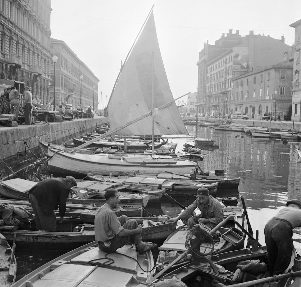 ca. 1950: Italian fishermen prepare for a night of fishing on Trieste's Grand Canal. (Three Lions/Getty Images)