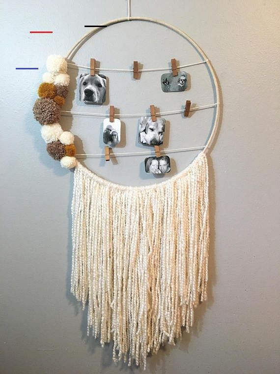 Photo Hanging Dreamcatcher, Pom Pom Dreamcatcher, Large Wall Hanging, Picture Hanging, Boho Wall Art, Boho Dreamcatcher, Wall Art - #macramewallhanging - This bohemian inspired piece is a unique and fun way to display your memories on the wall. I started with a 20 inch base wrapped in a light beige suede lace, I then suspended cream colored yarn & added a handmade yarn pom pom arrangement to give more texture and color to the piece. -3x3 photos or smaller work best -Holds 8 photos comfortably...