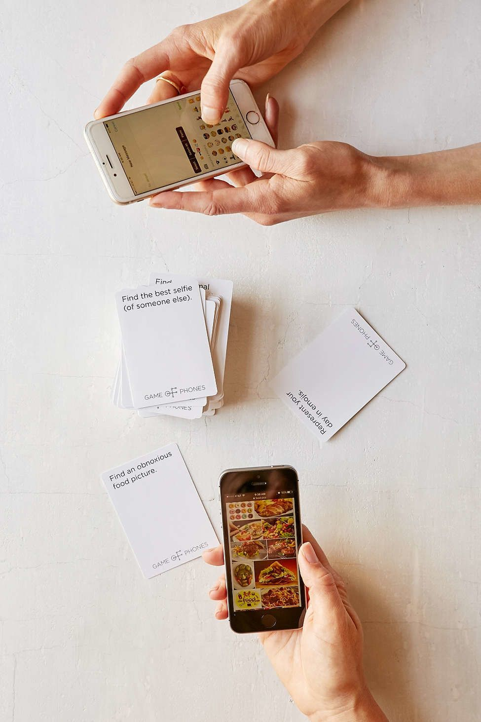 "And finally this ""Game of Phones"" card game is for him"