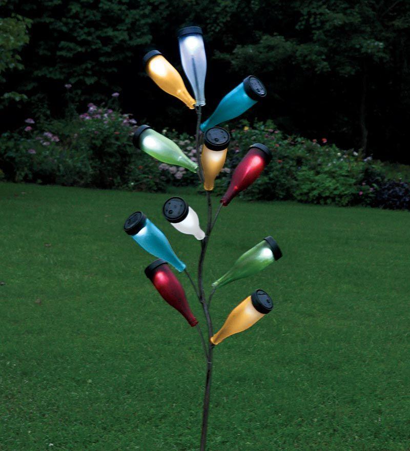 Metal bottle tree sculpture and colorful glass solar for Diy solar wine bottle lights