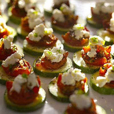 Zucchini rounds with goat cheese and sun dried tomato. 28 calories each!