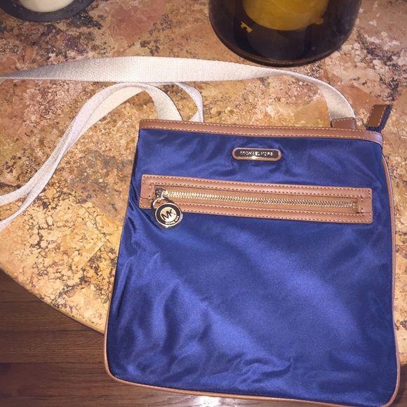 Michael Kors cross body nylon bag Navy blue nylon cross body. In excellent condition. Inside completely clean. Michael Kors Bags Crossbody Bags