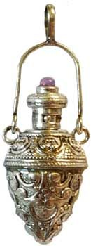 """This is so cool... Aroma Bottle pendant. This versatile pendant is an ancient design with raised motif and a cap with stone that really opens. Tiny hole to drop or soak your fragrance into. Some use this as a pendulum. 1 1/2"""".  Made in India. $30.95"""
