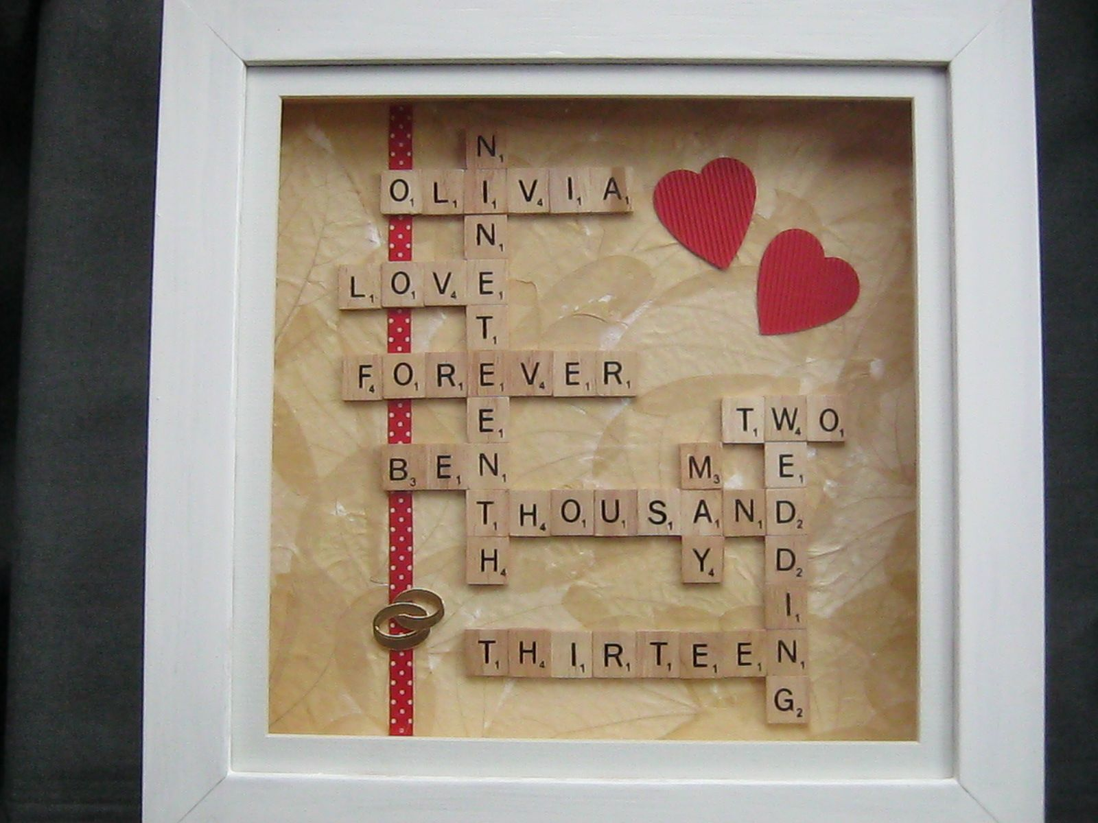 Use scrabble tiles to make a personalized box frame wedding or