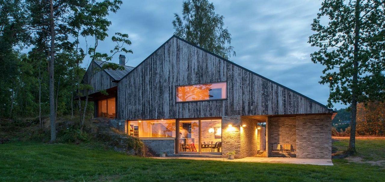 Maison bois et pierre très contemporaine au bord de falaises