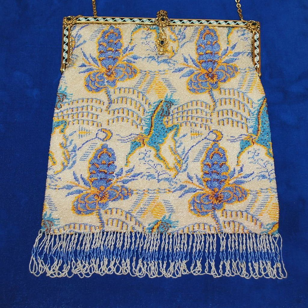 1920s beaded purse, attributed to the textile designs of the French artist, Raoul Dufy. Dufy was a French early 20th century painter who was influenced by Henri Matisse with a carefree whimsical Fauvist style using vivid colors and bold expression. He especially had an interest in depicting fanciful horses.  Measures approximately 7 x 10 inches