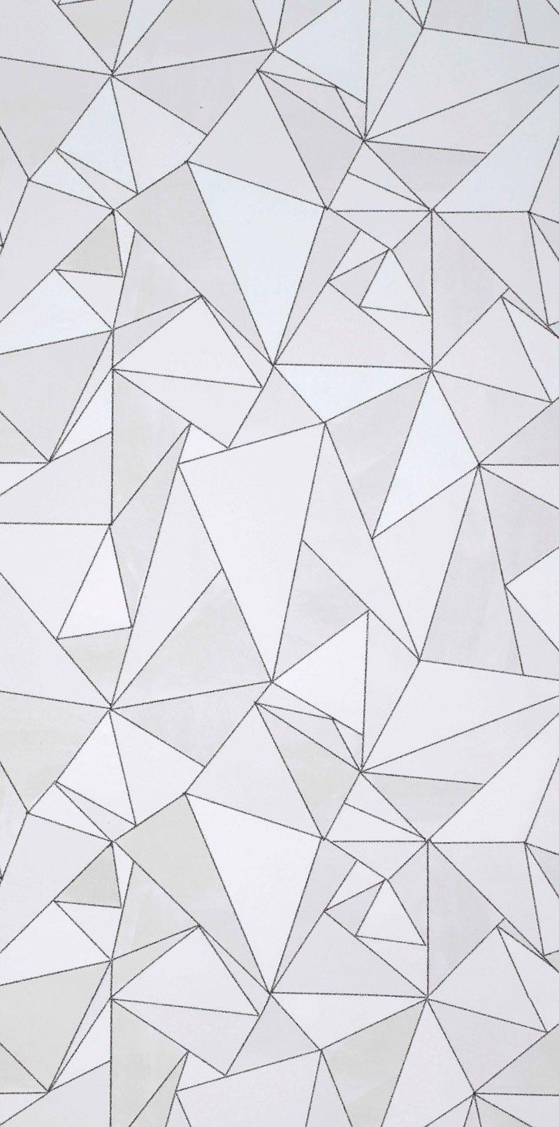 Grafiskt mönster med olikformade trianglar i vattenfärger som blev utnämnd till årets tapet i Sverige 2013 av tidningen Elle Decoration.Trots att tapeten kan