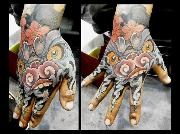 What Do You Think Of This Crazy Cool Hand Tattoo By Ching At East Tattoo In Taiwan Love Foo Dog Tattoo Hand Tattoos Japanese Hand Tattoos