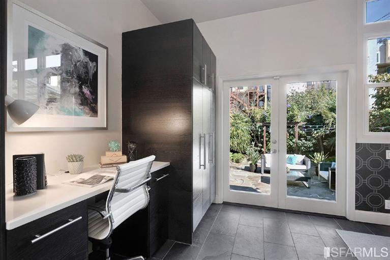 Modern Home Office with slate tile floors, interior wallpaper, Built-in bookshelf, High ceiling, Carpet