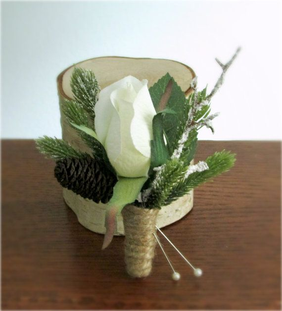 Snow Blossom Boutonniere - White silk rose accented with artificial frosted pine, snow covered branch or twig, and a natural miniature pine cone, #winterwedding, #PosiesPearls