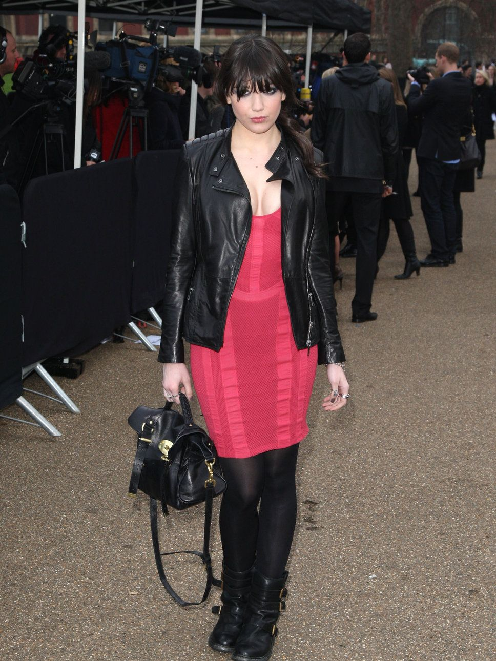 Daisy Lowe in red dress, red lips, black jacket and black ...