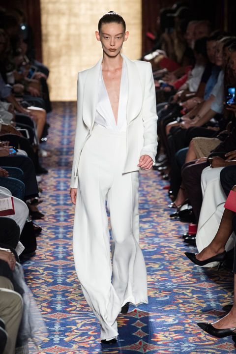 Planning a wedding soon? Check out these off-the-rack bridal looks you will love from NYFW, this sleek white suit from Brandon Maxwell is stylish and modern!