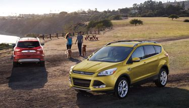 The Escape Titanium In Ruby Red Tinted Clearcoat Left And Karat Gold Ford News Car Ford Ford Escape