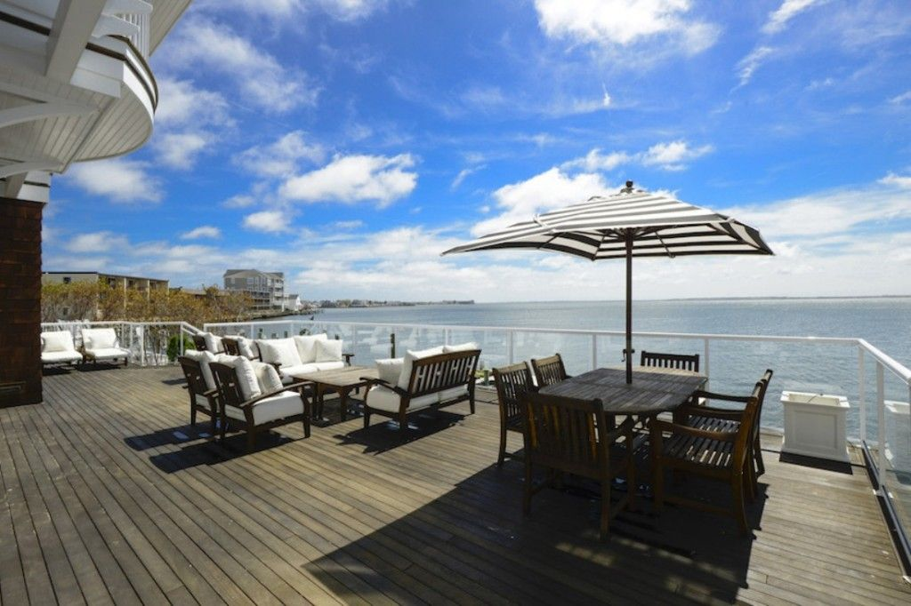 Architecture: Bay View Terrace With Timber Deck Also Wooden Outdoor Patio Table Umbrellas Design Ideas: Exquisite US Bayfront Estate in Ocean City, Worcester Country