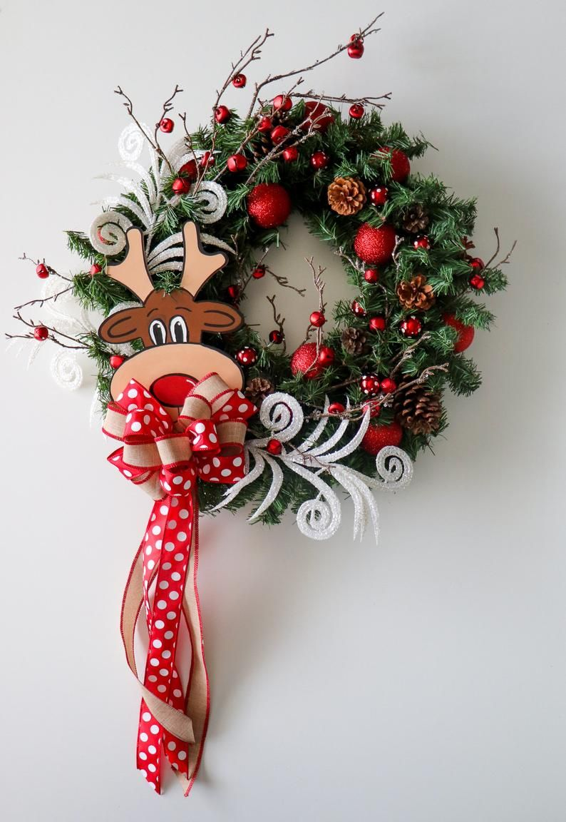 Every Child Has Heard The Story Of Rudolph The Red Nosed Reindeer Its A Classic And Heart War Christmas Wreaths Rustic Christmas Wreath Christmas Door Hanger
