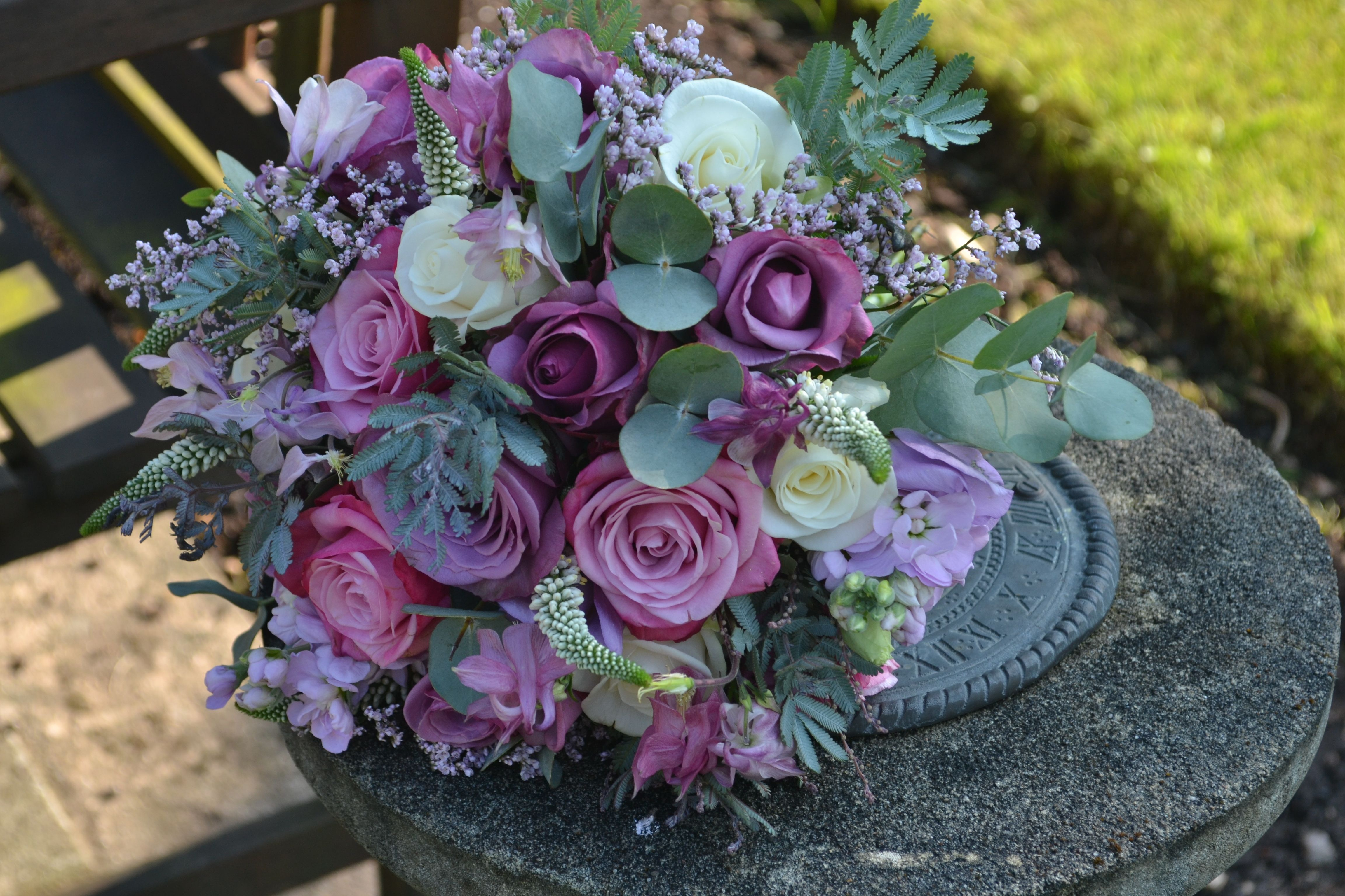 Dusky Pink And Lilac Roses With Eucalyptus For The Bridal Bouquet