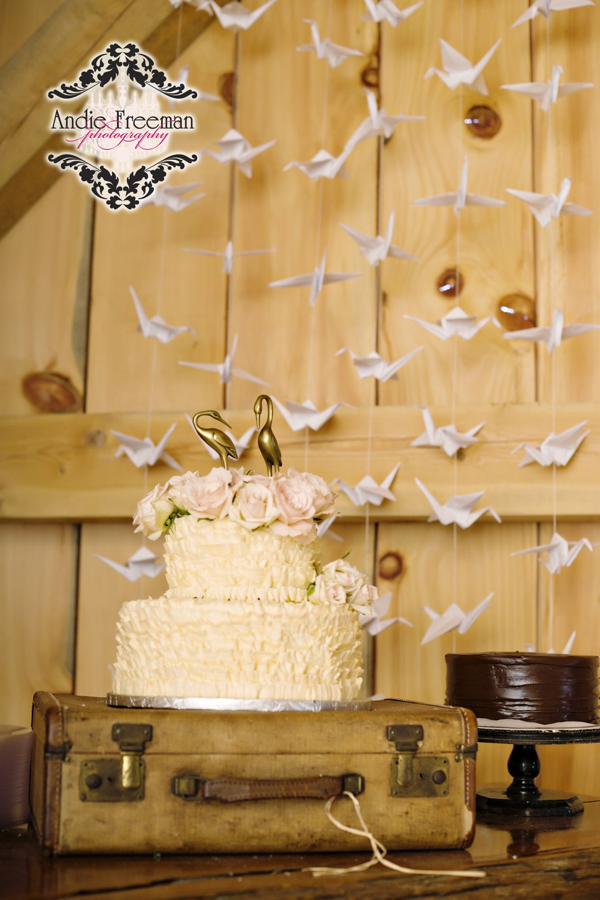 Barn wedding cake table ideas  Country barn wedding vintage cake with roses and crane cake topper