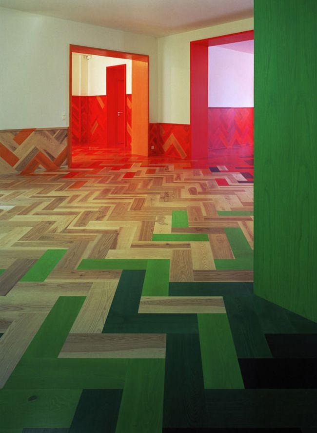 Tham & Videgård Arkitekter interior, Stockholm. Amazing colourful timber floor throughout.